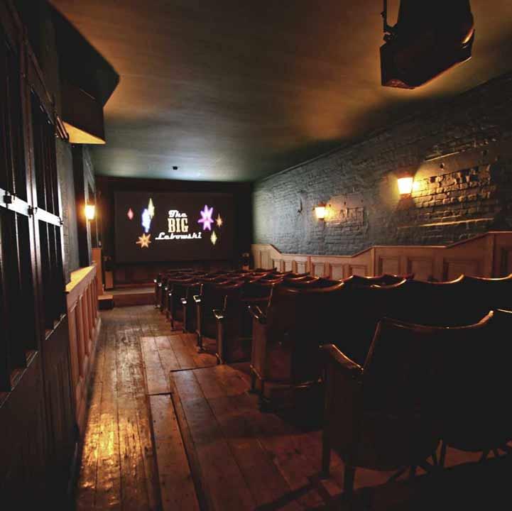 Cinema screen and seating inside TT Liquor