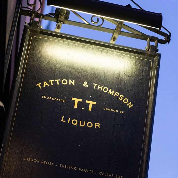 TT Liquor hanging shop sign