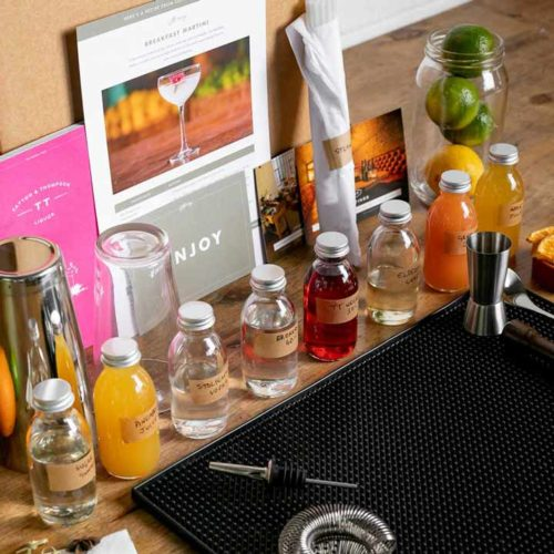 Laid out content of an online cocktail lesson box
